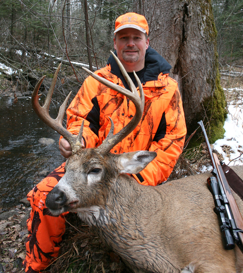 Doc's son Ken with his latest trophy buck. (2012, 8-pointer)