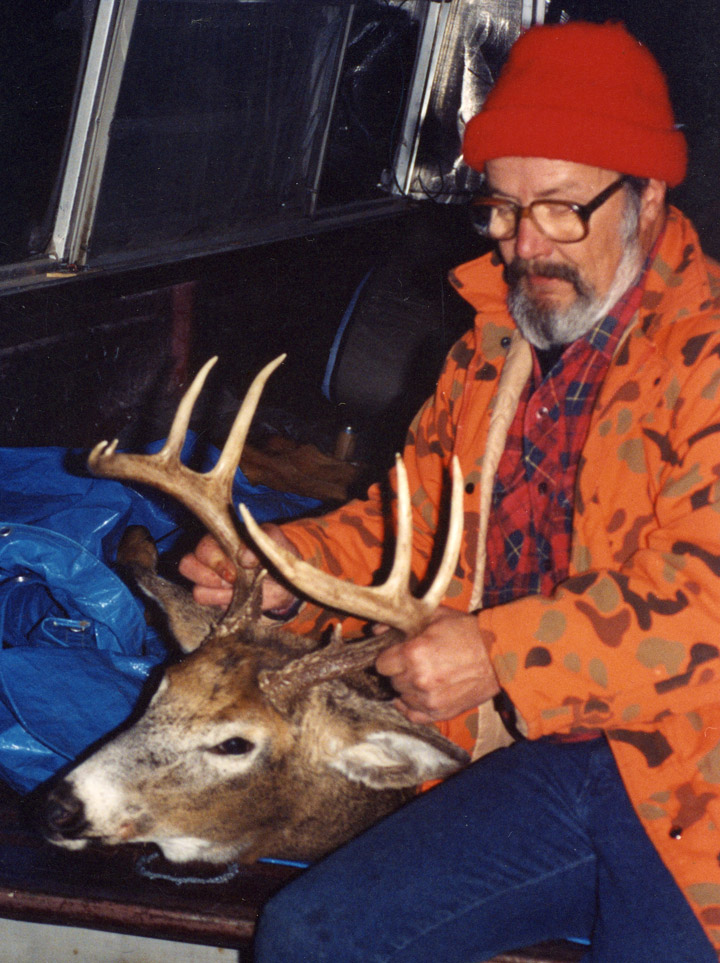Doc with his 1990 9-point whitetail buck, back at his truck.